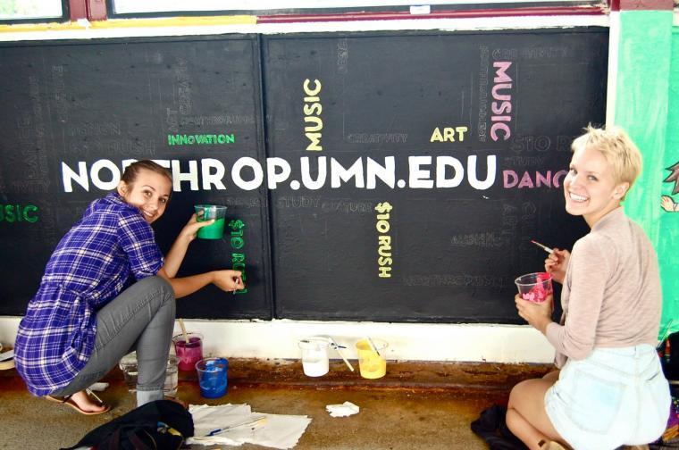 Students paint the bridge for Northrop!