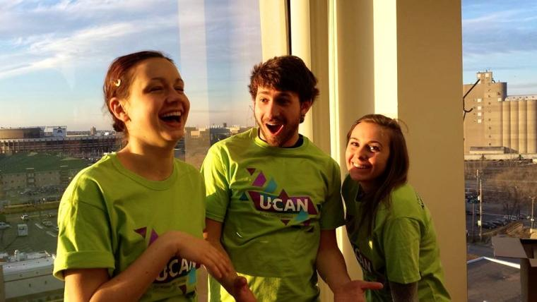 U-CAN students try on their new t-shirts!