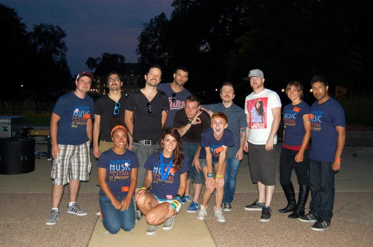 Students meet with the band after a summer concert on the plaza.
