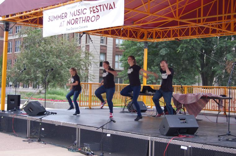 Student group, MinnesoTap, performs at a summer concert.