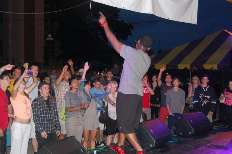 Students enjoy a hip hop show