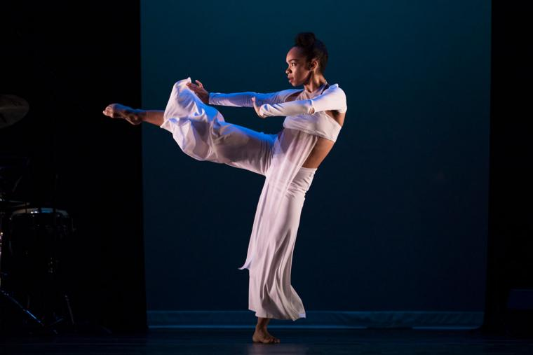 A female dancer wearing white performs on stage.