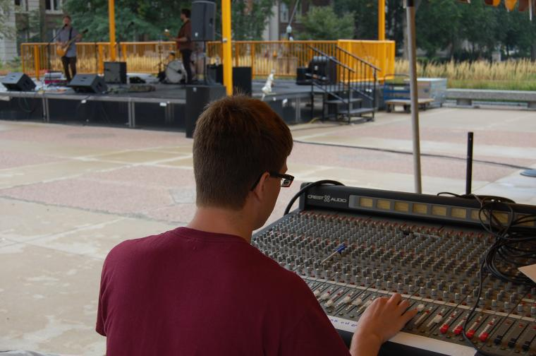 Student works at an outdoor concert
