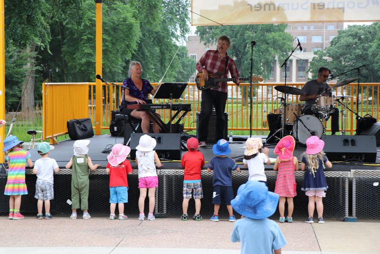 Small kids in hats at the front of the stage watching The Fragrants perform.