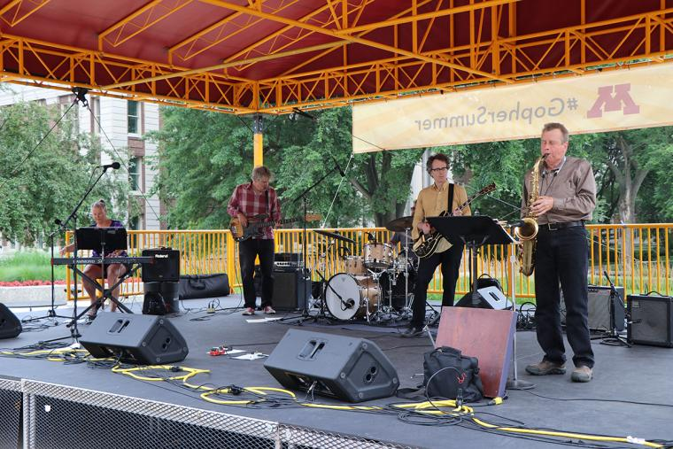 On stage from left to right: Sarah Burk, John Munson, Richard Medek, Jacques Wait, and Max Ray