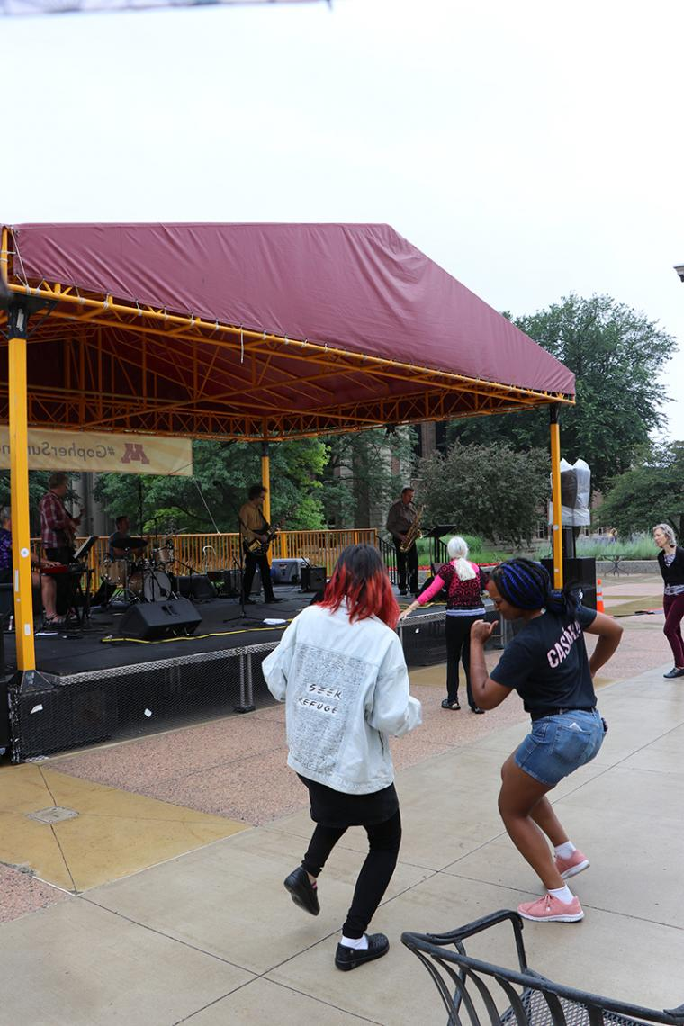 The audience dances in the rain to the music of The Fragrants
