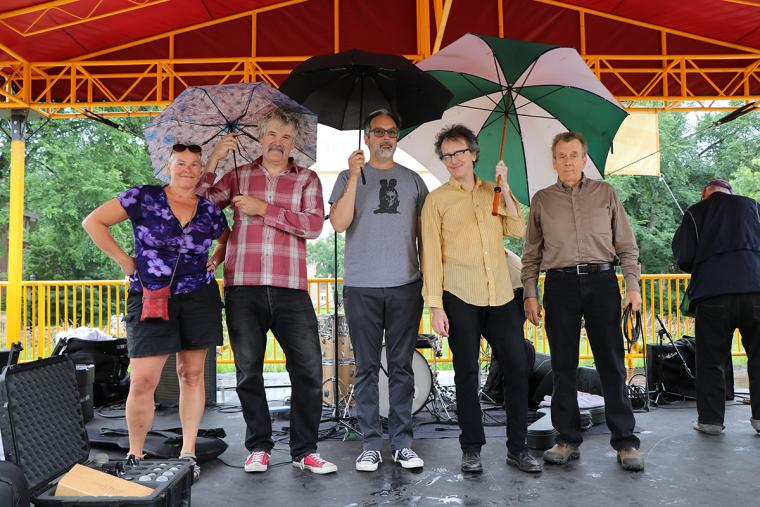 The Fragrants final bow on stage under umbrellas