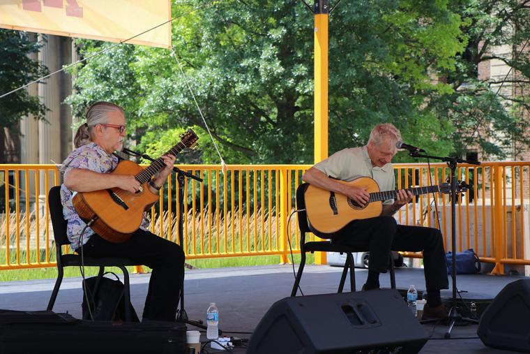 Tim Sparks and Phil Heywood playing their guitars on stage July 24.