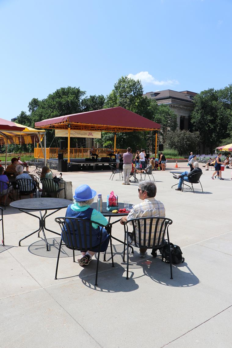 The lunchtime crowd listens to Tim Sparks and Phil Heywood at Northrop's Music on the Plaza.
