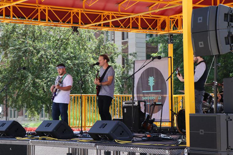 Dave Sandersfeld and his band on stage for Music on the Plaza.