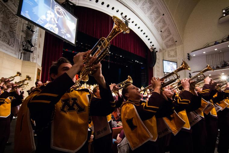 Trumpets play in front of the stage